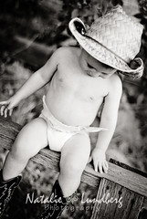 Down (Natalie Lundberg Photography) Tags: boy baby grass hat 50mm utah nikon toddler cowboy boots 18 sunflare d80