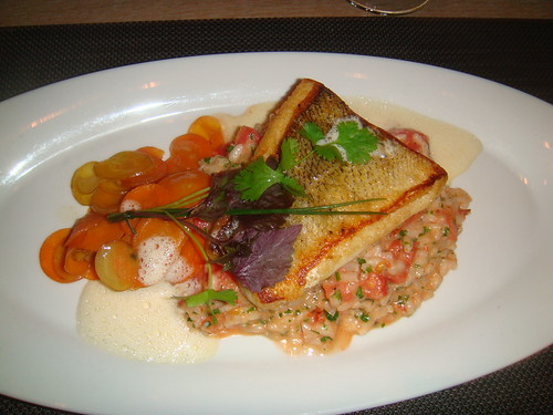 Pan seared Ontario Pickerel scallops with vichy carrots and charred tomato rissoto