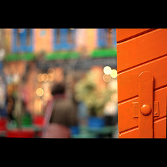 Orange Door (_nejire_) Tags: door uk blue england orange color colour green london lady canon wednesday eos 50mm kiss colorful bokeh britain explore colourful fp frontpage 50mmf18 15faves 9am 30faves fave20 50faves 10faves 20faves 40faves hbw 25faves nejire 400d eos400d fave15 kissx fave10 45faves fave30 goldstaraward bokehwednesday fave50 mhashi fave25 fave40 fave45 10224414g330pm 33851874g750am 23546774g030am