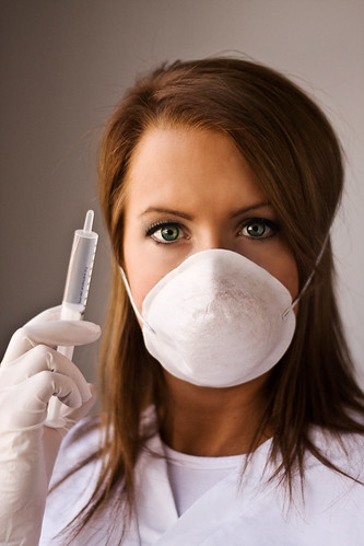 A model posing as a nurse in a surgical mask