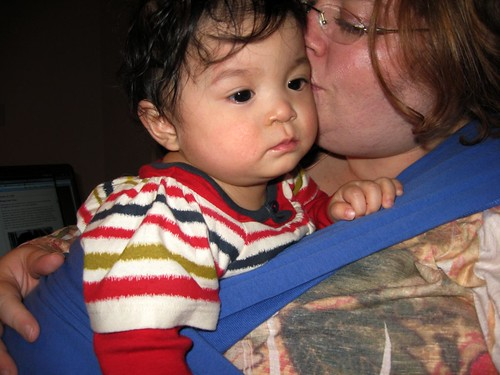 baby wearing with a kiss
