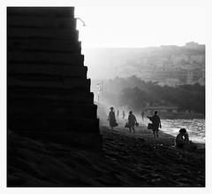 figures by the beach - stavrosstam (stavrosstam) Tags: shadow people bw cinema greece