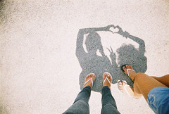 Keep Me Close (pattyequalsawesome) Tags: girls friends light shadow people 3 love film nature kids self 35mm lomo lomography sand fuji floor philippines memories grain negative thoughts batangas vivitar vignette 2009 province troubled paintingwithlightandshadows