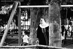 The swing (farnitano.amos) Tags: park street city people blackandwhite bw italy woman parco game rome roma donna europa europe italia child gente mother swing bn geo madre citt gioco musli bambino altalena stphotographia