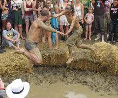 Wrestling Mid Air (Mrsuperpants) Tags: party music wet field festival garden fun dance mud wrestling secret 09 messy mudwrestling 2009 muddy sgp