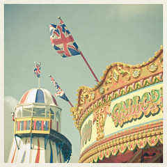 (_cassia_) Tags: summer amusement pier brighton multicoloured carousel flags british rides unionjack helterskelter gallopers cassiabeckcom