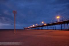 Lighting the way (~Glen B~) Tags: blue red orange beach sign yellow lights pier sand shadows mud deep southport quicksand redbubble:id=38779182lightingtheway