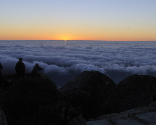 Sun sets over the clouds around Table Mountain