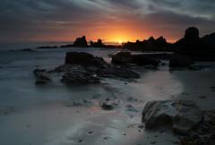 Distant Glow (vix227) Tags: ocean california longexposure sunset slr beach clouds coast rocks newportbeach canonrebel canonxt canoneos delmar