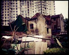 Awaiting demolition (avezink) Tags: china houses tlr analog creek condemned shanghai kodak toycamera slide demolition historic roofs lubitel  ektachrome slums expiredfilm  russiancamera hongkou  qiujianglu  expiredin1990 tiredmetaphoroldandnew