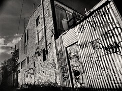 fitzroy gothic #6 (mugley) Tags: old sky blackandwhite bw building brick 120 film wall clouds rollei fence mediumformat graffiti alley 645 suburban decay pipes fitzroy grain australia melbourne tags victoria negative lane epson suburbs powerline polarizer 6x45 r3 mamiya645 corrugatediron urbanlandscape redfilter polariser 25a id11 v700 mamiya645protl ilfotec m645 rolleir3 35mmf35sekorn forgetexactlywhere offfitzroyst taggershaveteensyweensytools
