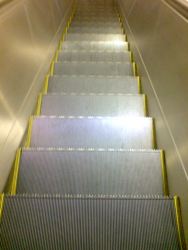Where's the yellow box on the escalator?