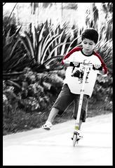 Run Boy Run (Sabrina Campagna) Tags: park street boy bw parco white black blur youth lumix photography strada campania child play scooter run bn panasonic 50 bianco nero fz salerno corsa gioco ragazzo bambino fz50 monopattino mercatello