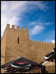 Zero...integration (el_morisco) Tags: blue sky azul umbrella parasol cielo cdiz sombrilla castillo rota castillodeluna