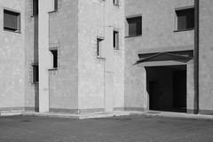 Retri (Al_fred) Tags: bw italy architecture italia case bn backsides viterbo architettura tarquinia enel retri paoloportoghesi dipendenti ammucchiate