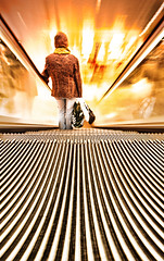 Woman on an Escalator (Semi-detached) Tags: light orange woman john shopping scotland nikon edinburgh long exposure shot angle escalator wide perspective lewis sigma an 1020mm 1020 aplusphoto
