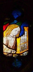 Organetto-playing angel (robin.croft) Tags: angel stainedglass medieval fairford organetto angemusicien