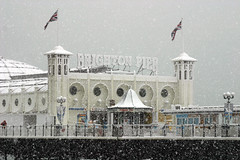 Brighton Pier In The Snow, Brighton & Hove, England. (Ben Ward In Hove) Tags: winter england snow storm cold ice weather warning canon snowflakes coast pier seaside brighton frost traffic snowy hove flag south snowstorm frosty chilly snowing icy blizzard unionjack eastsussex winterwonderland severe unseasonal disruption benward brightonandhove brightonhove benwardinhove benedictward