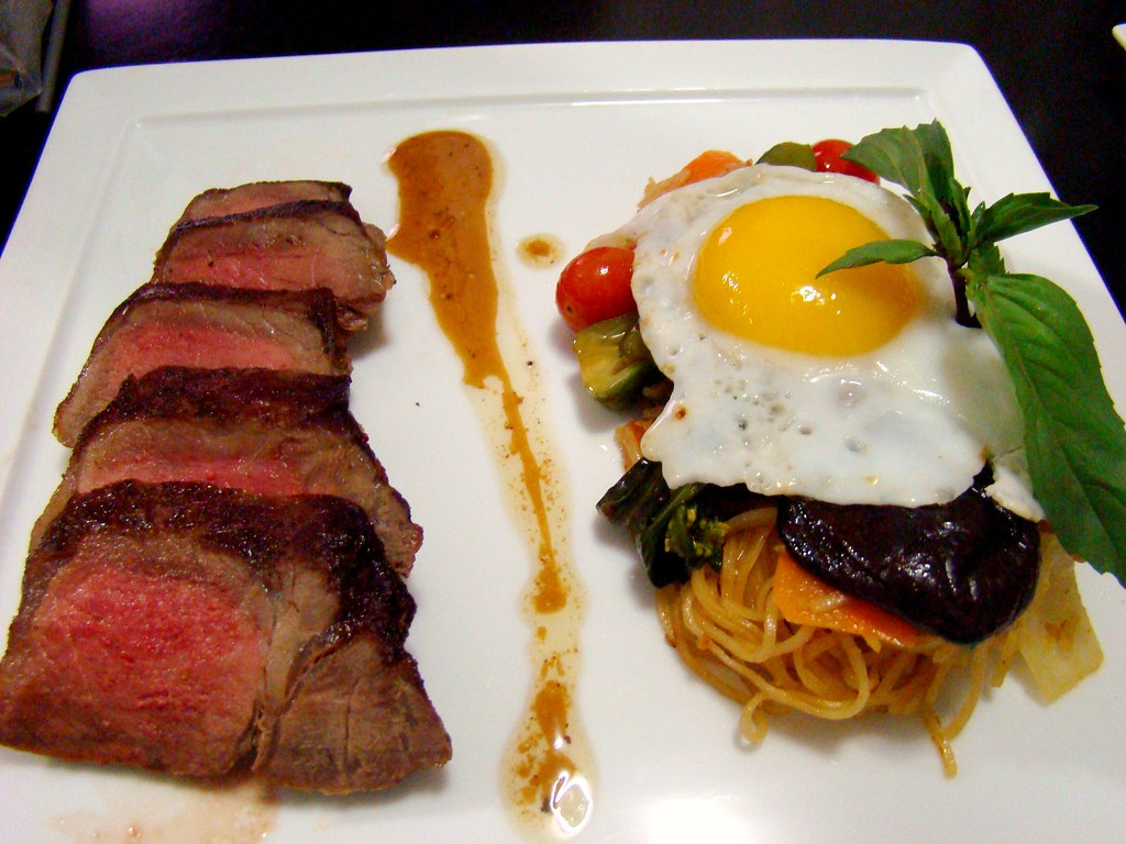 Roasted Shell steak with Duck Egg and Pad Thai