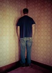 standing in the corner