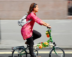 Summer flowers (jeremyhughes) Tags: street city pink flowers summer woman motion london yellow movement nikon zoom sunny explore sunflowers nikkor panning foldingbike brompton decorated 1870 decoratedbike d40 jeremyhughes foldie bromptonfoldingbicycle