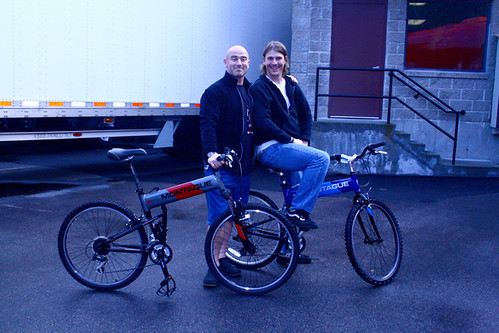 As proud owners, two of the crew members pose with their new Montague folding bikes.