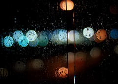 Another Rainy Night (gardinergirl) Tags: blue red toronto water glass rain night highway bokeh circles headlights explore freeway raindrops fp taillights 50mm18 gardinerexpressway frommybalcony explored july2009 themonthofrain