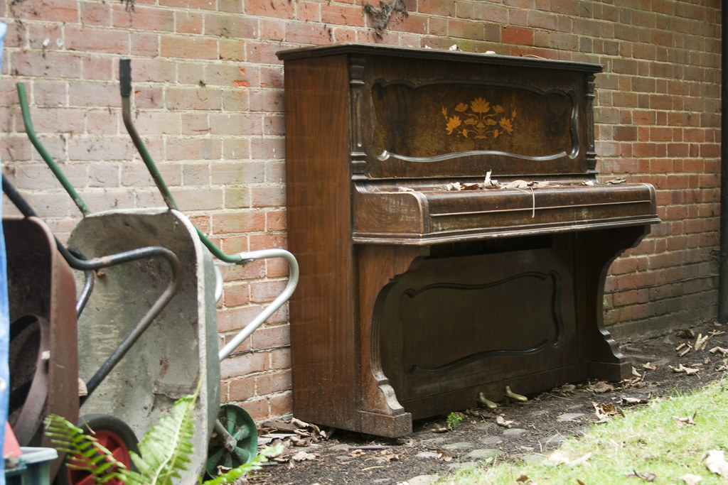 Upright Piano, with a light dusting of leaves