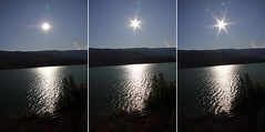 Aperture Flare 2 (LongInt57) Tags: railroad blue trees sky sun white mountain lake black mountains reflection tree silhouette reflections landscape grey landscapes diptych triptych gray lakes scenic tracks silhouettes railway flare rays railways flares railroads triptychs diptychs mindigtopponalwaysontop