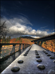 Faskally Bridge (angus clyne) Tags: new bridge autumn trees storm fall colors clouds canon walking scotland paint rivets colours hand angle wind footbridge angus path walk steel north wide scottish rail bluesky glen explore crop 5d 20mm loch railing across hdr pitlochry a9 clyne flikcr roadbridge faskally lochfaskally colorphotoaward
