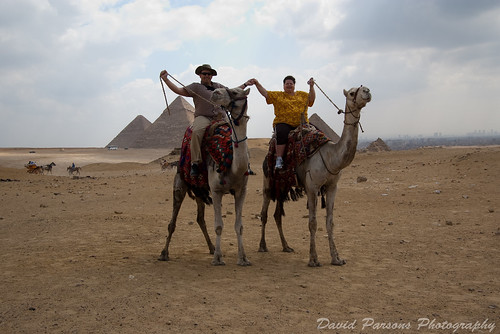 Us on camels in front of the Pyramids