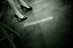 the shill (JKnig) Tags: bw woman concrete highheel floor leg vendor heel stiletto shootingfromthehip motorcycleshow shill itskindofdisturbingactually manyofthevendorshirewomentohandoutflyersandcoupons