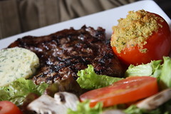 my sister's steak (cathou_cathare) Tags: paris france caf cuisine restaurant foods salad beef meat butter steak grilled salade tomate tomatoe plat beurre breadcrust bistrot welldone viande boeuf grill chapelure biencuit levavin assierre