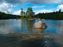 View from Bartlett Carry on Upper Saranac Lake (pa_cosgrove) Tags: trees lake nature water landscape rocks peaceful adirondacks evergreen evergreens uppersaranaclake bartlettcarry canong10