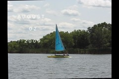 V I D E O -- Sailing Busse Lake -- WindRider + Sunfish -- Sailboat -- Crossing Paths -- Video (ellenbusse) Tags: summer usa lake chicago bikepath sailboat forest boat video fishing dock woods busse sailing sails august il boating sail preserve 2009 sunfish cookcounty windrider bussewoods busselake
