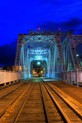 The Johnson Street Bridge: Victoria B.C (Brandon Godfrey) Tags: world pictures wood city longexposure bridge blue urban canada beautiful st night train wonderful landscape photography photo vanishingpoint amazing fantastic scenery long exposure cityscape bc shot photos shots pics earth britishcolumbia sony scenic tracks picture pic scene images victoria vancouverisland deck creativecommons pacificnorthwest northamerica unreal alpha dslr incredible hdr highdynamicrange outstanding josephstrauss thebluehour a300 basculebridge photomatix gallopinggoosetrail thechallengegame challengegamewinner dslra300 sonya300 100commentgroup thejohnsonstreetbridge