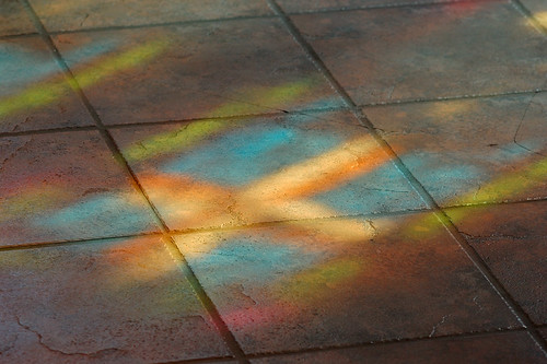 Light from stained glass window upon tile floor, at Saint Peter Roman Catholic Church, in Saint Charles, Missouri, USA