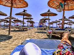Chilling at mallorca (mr.hemmo) Tags: blue sun white painterly beach hat umbrella spain sand chairs sony leg towel sunshade shorts mallorca topaz lucis edhardy dschx1 overprosessedpicture