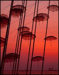 red umbrellas in Thessaloniki Greece (maios) Tags: travel sunset red sea sky orange color water port photo europa flickr ship foto photographer hellas greece macedonia thessaloniki fotografia umbrellas salonica manikis maios iosif  heliography    mywinners zogolopoulos
