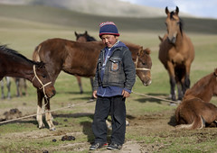 Boy with Horses,  Song Kol Lake, Kyrgyzstan (Eric Lafforgue) Tags: boy horses people horse male childhood animal horizontal youth standing mammal person one kid asia exterior fulllength pasture innocence centralasia kyrgyzstan humanbeing nomads oneperson colorphoto bridle kyrgyzrepublic kirghizistan kirgistan lookingatcamera 9769 kirghizstan kirgisistan  nomadiclifestyle   quirguizisto songkollakearea jamanechkijailoo