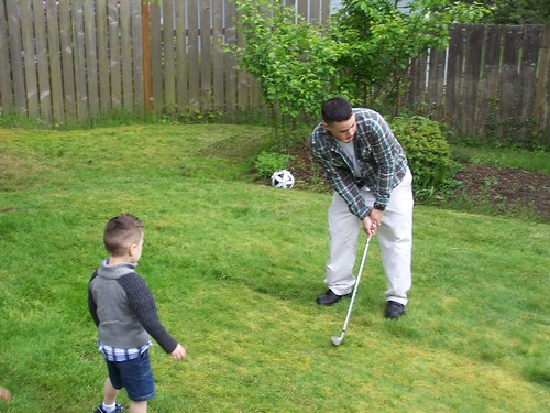 may 189 Anthony teaching Little Anthony to golf