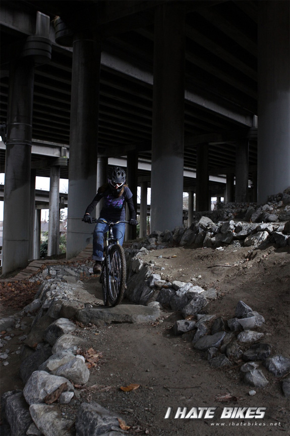 Inga rides a section of trail under the bridge one time...