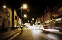 (andrewlee1967) Tags: street uk england motion bike bicycle night speed blurry cyclist traffic zoom britain streetlamps gb shops incar highstreet stalybridge sigma1020mm andrewlee 50d tameside mywinners andrewlee1967 canon50d