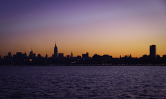 A city aglow (Singing With Light) Tags: nyc morning blue red orange ny water colors skyline clouds sunrise newjersey cool jerseycity place purple pentax manhattan nj eastriver nyskyline hudsonriver empirestate chrysler exchangeplace jjp clor exchnage k200d