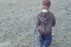 A Boy And His Stick (granola_gir07) Tags: boy meadow stick naturewalk