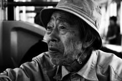 107 year old (dzpixel) Tags: old bw man face japan train canon japanese tokyo expression portait jr age rides asakusa akiba nihon densha riddle dz earthasia samlam dzpixel 107year