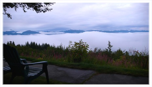 Fog fills Kachemak Bay, morning view from Bay View Inn.