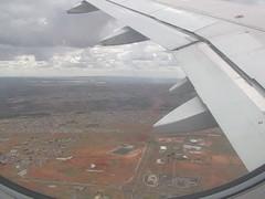 Stopping by Brasilia (benyeuda) Tags: city brazil sky southamerica plane buildings airplane flying video capital wing brasilia brazilia