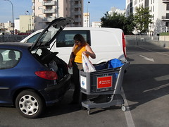 Woman Loading Car Trunck from Blue Plastic Shopping Cart. (Polycart) Tags: blue light woman green car comfortable self shopping bag handle one store long all silent trolley rfid parking gray lot environmental supermarket plastic whole single friendly trunk service block safe easy van cart grocery piece stores eco carts groceries supermarkets trolleys compact recyclable robust polypropylene hypermarket p180 lasting hypermarkets