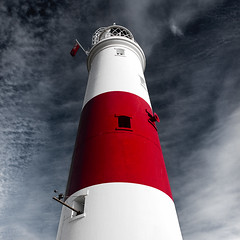 Big Red (Andy Brown (mrbuk1)) Tags: light shadow sky cloud lighthouse building tower window lamp vertical architecture square 3d angle bright vibrant flag stripe band symmetry coastal desaturation striking unionjack powerful siren circular lifesaver bold sentinel portlandbill foghorn appendage blackwhiteredallover artofimages bestcapturesaoi oooohisntittall elitegalleryaoi